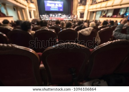 Blurred Audience in a theater, on a concert. Viewers watching the show. #1096106864
