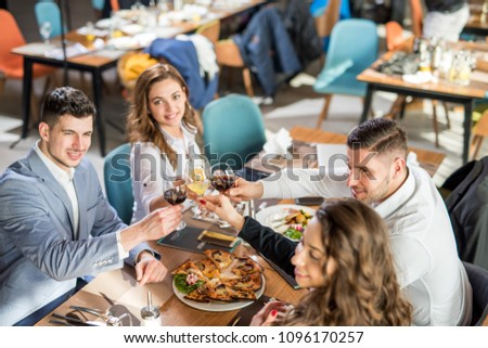 A group of business men and woman having a nice dinner. #1096170257