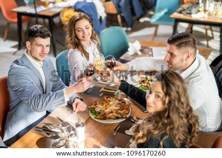 A group of business men and woman having a nice dinner. #1096170260