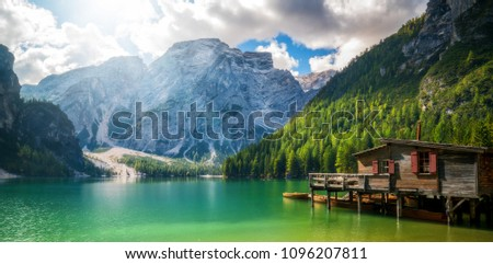 Braies Lake in Dolomites mountains forest trail in background, Sudtirol, Italy. Lake Braies is also known as Lago di Braies. The lake is surrounded by forest which are famous for scenic hiking trails. #1096207811