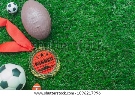 Table top view aerial image soccer or football tournament season background.Flat lay ball with accessories decorations items on the artificial green grass wallpaper.free space for creative design text #1096217996