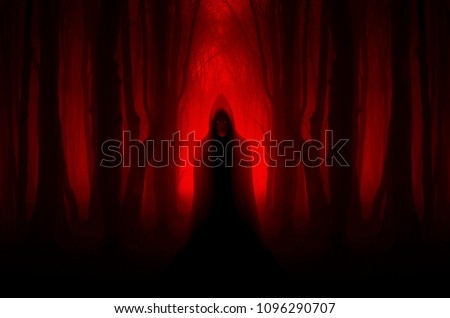 scary ghostly figure in haunted forest, halloween nightmare scene Royalty-Free Stock Photo #1096290707