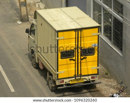 Bangalore, Karnataka, India - May 20 2018 Yellow color grocery delivery truck parked on the road #1096320260