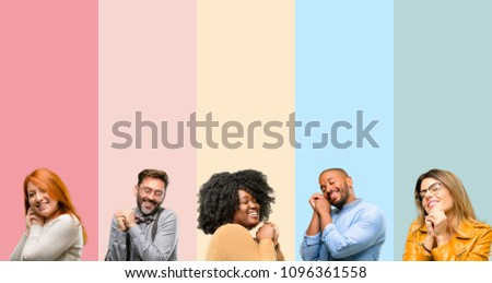 Cool group of people, woman and man confident and happy with a big natural smile laughing #1096361558