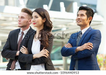 Successful business team with arms crossed with outdoor background #1096440953