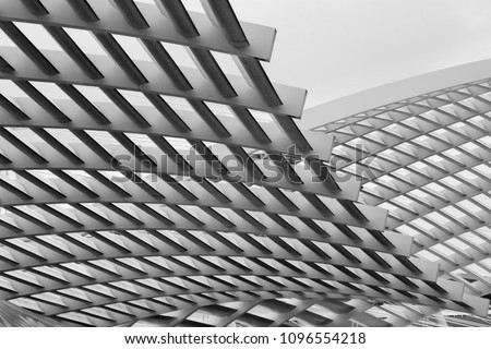 Close-up photo of technological metal grid structure. Abstract black and white background image on the subject of modern architecture, industry or technology. #1096554218