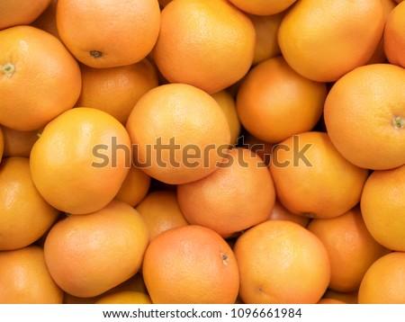 Grapefruit harvest. many grapefruit. grapefruits for food textures and backgrounds. Landscape. A backdrop of grapefruits. Street vegetable market #1096661984