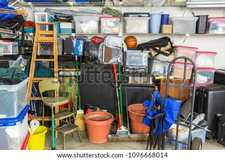 Messy cluttered garage filled with various household storage items. Royalty-Free Stock Photo #1096668014