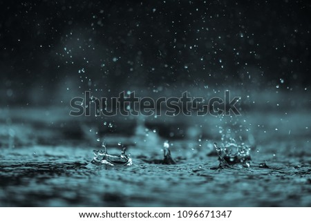 Rain water drop falling to the floor in heavy rain day  Royalty-Free Stock Photo #1096671347