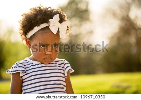 Little girl being disciplined  pouting and looking sad.  #1096710350