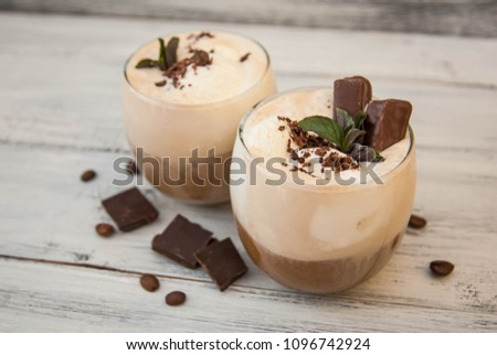 Iced mocha coffee with whip cream. Summer drinking times. Coffee beans. Rustic textured wooden background.  #1096742924