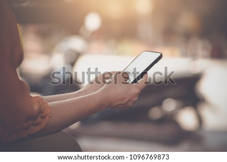 Woman typing text message on smart phone #1096769873