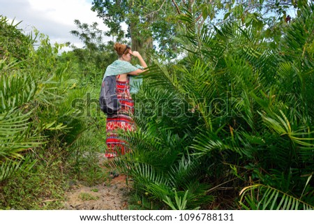 Relaxing tourist on the trekking in the jungle on Dominican Republic. Forest of the Del Este national park close the capital city Santo Domingo #1096788131
