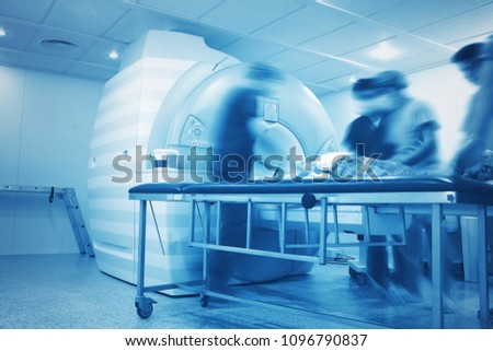 Preparation to the MRI scanning process of critically ill person in the hospital department of radiology. #1096790837