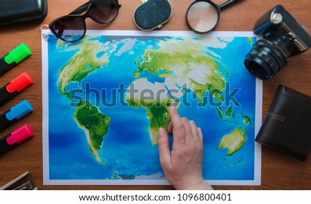 World map on a wooden table top view. Concept travel adventure vacation #1096800401