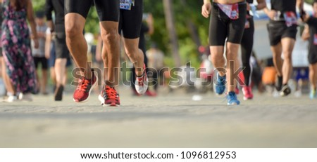 legs of a marathon runner during a competition #1096812953