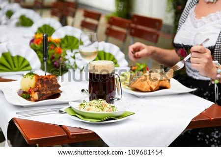 female eating at the oktoberfest #109681454