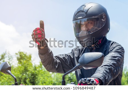 Man in a Motorcycle with helmet and gloves is an important protective clothing for motorcycling throttle control,safety concept #1096849487