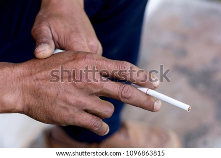 Human hand using cigarette,health concep #1096863815