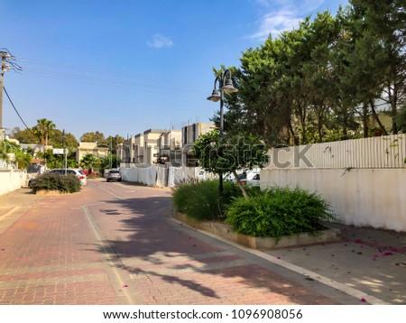 RISHON LE ZION, ISRAEL - APRIL 30, 2018: Street in Rishon LeZion, Israel. #1096908056