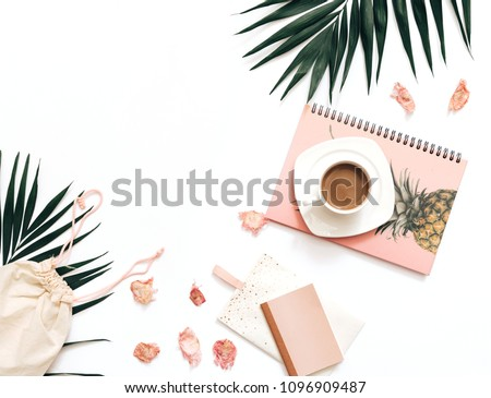 Flat lay blogger workspace mockup with tropical leaves , coffee and accessories on white background. Copy space  #1096909487
