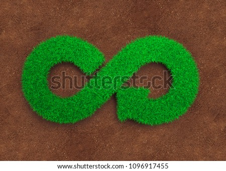 ECO and circular economy concept. The green grass in form of arrow infinity recycling symbol and red soil background. #1096917455