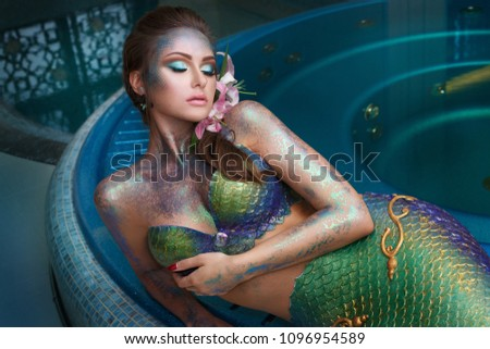 Fashion portrait of a girl in a mermaid costume at a spa. #1096954589