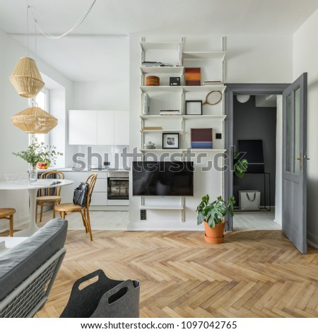 Hygge home interior with wooden floor, tv and bookcase #1097042765