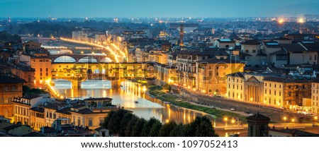 Florence Ponte Vecchio Bridge at Night Skyline in Italy. Florence is capital city of the Tuscany region of central Italy. Florence was center of Italy medieval trade and wealthiest cities of past era. #1097052413