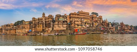 Varanasi India ancient city architecture panoramic view at sunset as seen from a boat on river Ganges. #1097058746