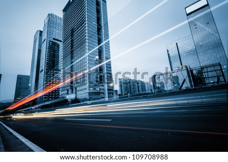 the light trails on the modern building background in shanghai china. #109708988
