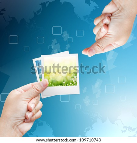 hand of women and Picture frame on background blue #109710743
