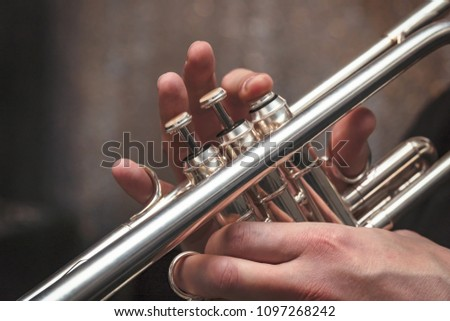 Hand of the Trumpeter on the buttons of the trumpet #1097268242