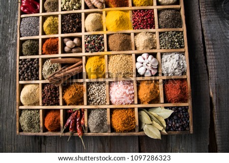 Close-up of different types of Assorted Spices in a wooden box #1097286323