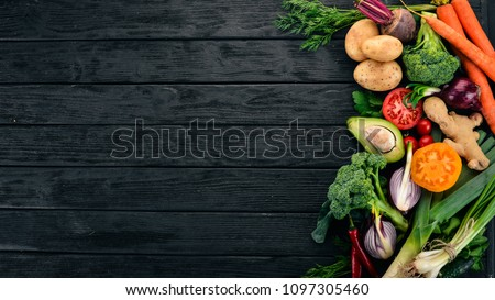 Healthy food. Vegetables and fruits. On a black wooden background. Top view. Copy space. #1097305460