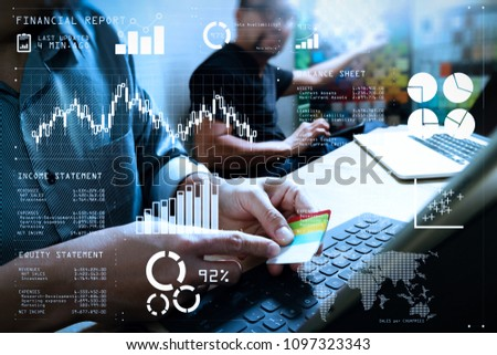 Financial report data of business operations (balance sheet and  income statement and diagram) as Fintech concept.Coworking process, entrepreneur team working in creative office space using table #1097323343