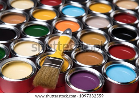 Tin cans with paint, brushes and bright palette of colors #1097332559