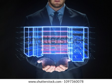 architecture, technology and construction concept - close up of businessman with virtual building blueprint projection #1097360078