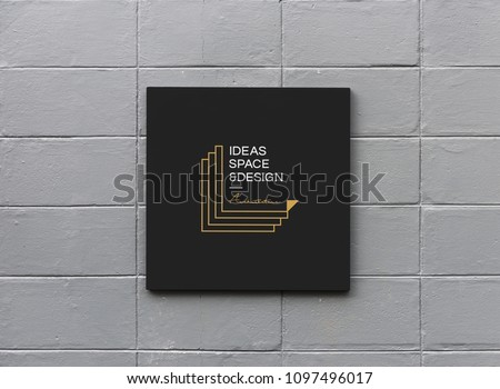 Black sign on a white wall mockup