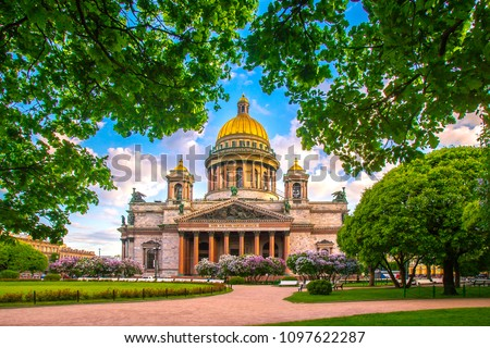 Saint Petersburg. Saint Isaac's Cathedral. Museums of Petersburg. St. Isaac's Square. Summer in St. Petersburg. St. Isaac's Cathedral in the crowns of trees. Russia. Royalty-Free Stock Photo #1097622287