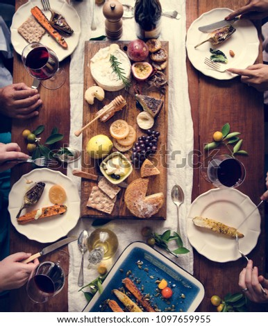 Adults eating a cheese platter food photography recipe idea #1097659955