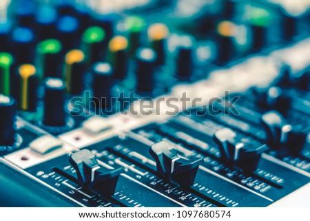 Closeup some part of audio mixer, vintage film style, music equipment concept #1097680574