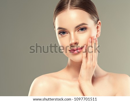 Young woman with beauty skin healthy face close up #1097701511