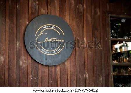 Black sign on a wooden wall mockup #1097796452