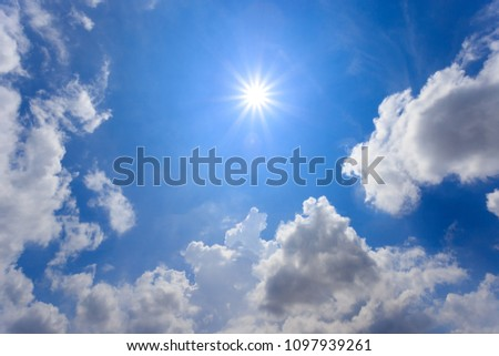 The sun shines bright in the daytime in summer. The natural blue background has a breeze on a bright day in the summer.The sky and clouds are not the same shape as the weather. #1097939261