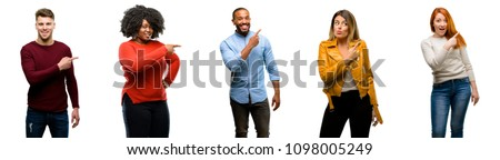 Group of cool people, woman and man pointing away side with finger #1098005249