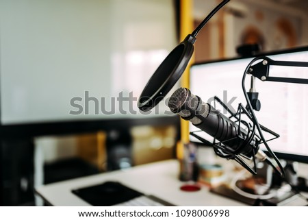 Close-up image of microphone in podcast studio.