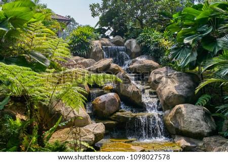 Perdana Botanical Garden small waterfall view in Kuala Lumpur, Malaysia #1098027578