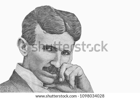 Portrait of scientist Nikola Tesla. Nobel Prize winning physicist Nicola Tesla, who discovered electromagnetic field theory. An Old paper banknote, vintage retro. Famous ancient Banknotes. Collection. #1098034028