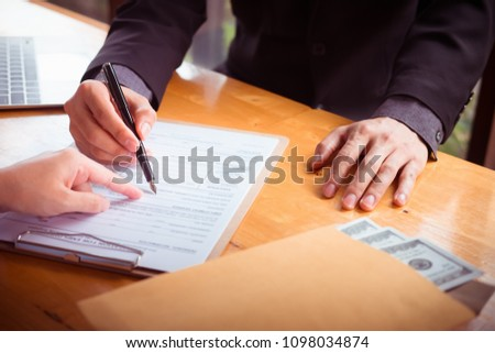 Asian business individual who owns the business sign personally sealing the deal with receiving a bribe money.The concept of corruption and anti bribery #1098034874